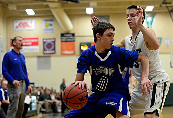 """Longmont's Justinian Jessup (10) is pressured by D'Evelyn's Connor Skelton (3) during the game at D'Evelyn High School on Saturday, March 2, 2013. Longmont lost to D'Evelyn 72-58. For more photos visit  <a href=""""http://www.BoCoPreps.com"""">http://www.BoCoPreps.com</a>.<br /> (Greg Lindstrom/Times-Call)"""