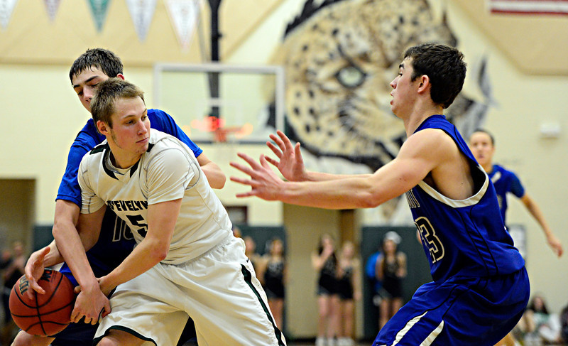 "Longmont's Justinian Jessup, left, fouls D'Evelyn's Chase Cleary during the game at D'Evelyn High School on Saturday, March 2, 2013. Longmont lost to D'Evelyn 72-58. For more photos visit  <a href=""http://www.BoCoPreps.com"">http://www.BoCoPreps.com</a>.<br /> (Greg Lindstrom/Times-Call)"