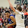 "Longmont's Kevin Mitchell drives the lane against D'Evelyn's Chase Cleary (5) during the game at D'Evelyn High School on Saturday, March 2, 2013. Longmont lost to D'Evelyn 72-58. For more photos visit  <a href=""http://www.BoCoPreps.com"">http://www.BoCoPreps.com</a>.<br /> (Greg Lindstrom/Times-Call)"