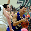 """Longmont's Kevin Mitchell (34) looks to shoot over D'Evelyn defenders during the game at D'Evelyn High School on Saturday, March 2, 2013. Longmont lost to D'Evelyn 72-58. For more photos visit  <a href=""""http://www.BoCoPreps.com"""">http://www.BoCoPreps.com</a>.<br /> (Greg Lindstrom/Times-Call)"""