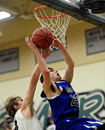 """Longmont's Eli Sullivan (23) shoots over D'Evelyn's Cody Marvel (4) during the game at D'Evelyn High School on Saturday, March 2, 2013. Longmont lost to D'Evelyn 72-58. For more photos visit  <a href=""""http://www.BoCoPreps.com"""">http://www.BoCoPreps.com</a>.<br /> (Greg Lindstrom/Times-Call)"""