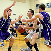 """Longmont's Felipe Alaniz (3) drives the lane against Discovery Canyon defenders during the game at D'Evelyn High School on Friday, March 1, 2013. Longmont beat Discovery Canyon 53-42. For more photos visit  <a href=""""http://www.BoCoPreps.com"""">http://www.BoCoPreps.com</a>.<br /> (Greg Lindstrom/Times-Call)"""