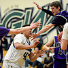 """Longmont's Marcus Johnson (43) sneaks a pass through Discovery Canyon defenders to teammate Justinian Jessup (10) during the game at D'Evelyn High School on Friday, March 1, 2013. Longmont beat Discovery Canyon 53-42. For more photos visit  <a href=""""http://www.BoCoPreps.com"""">http://www.BoCoPreps.com</a>.<br /> (Greg Lindstrom/Times-Call)"""