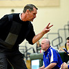 """Longmont head coach Jeff Kloster signals to players on the bench during the game at D'Evelyn High School on Friday, March 1, 2013. Longmont beat Discovery Canyon 53-42. For more photos visit  <a href=""""http://www.BoCoPreps.com"""">http://www.BoCoPreps.com</a>.<br /> (Greg Lindstrom/Times-Call)"""