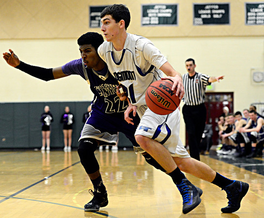 "Longmont's Austin Kemp (21) drives past Discovery Canyon's John Howlette (22) during the game at D'Evelyn High School on Friday, March 1, 2013. Longmont beat Discovery Canyon 53-42. For more photos visit  <a href=""http://www.BoCoPreps.com"">http://www.BoCoPreps.com</a>.<br /> (Greg Lindstrom/Times-Call)"