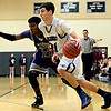 """Longmont's Austin Kemp (21) drives past Discovery Canyon's John Howlette (22) during the game at D'Evelyn High School on Friday, March 1, 2013. Longmont beat Discovery Canyon 53-42. For more photos visit  <a href=""""http://www.BoCoPreps.com"""">http://www.BoCoPreps.com</a>.<br /> (Greg Lindstrom/Times-Call)"""