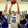 """Longmont's Marcus Johnson (43) shoots over Discovery Canyon's Andy Stuffer (44) during the game at D'Evelyn High School on Friday, March 1, 2013. Longmont beat Discovery Canyon 53-42. For more photos visit  <a href=""""http://www.BoCoPreps.com"""">http://www.BoCoPreps.com</a>.<br /> (Greg Lindstrom/Times-Call)"""