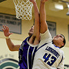 """Longmont's Marcus Johnson (43) battles for a rebound against Discovery Canyon's Andy Stauffer (44) during the game at D'Evelyn High School on Friday, March 1, 2013. Longmont beat Discovery Canyon 53-42. For more photos visit  <a href=""""http://www.BoCoPreps.com"""">http://www.BoCoPreps.com</a>.<br /> (Greg Lindstrom/Times-Call)"""