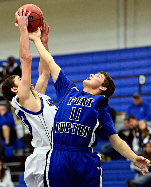 """Longmont's Eli Sullivan, left, and Fort Lupton's Colton McCutchan (11) compete for a rebound during the game at Longmont High School on Tuesday, Dec. 4, 2012. Longmont beat Fort Lupton 47-34. For more photos visit  <a href=""""http://www.BoCoPreps.com"""">http://www.BoCoPreps.com</a>.<br /> (Greg Lindstrom/Times-Call)"""
