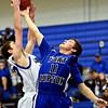 "Longmont's Eli Sullivan, left, and Fort Lupton's Colton McCutchan (11) compete for a rebound during the game at Longmont High School on Tuesday, Dec. 4, 2012. Longmont beat Fort Lupton 47-34. For more photos visit  <a href=""http://www.BoCoPreps.com"">http://www.BoCoPreps.com</a>.<br /> (Greg Lindstrom/Times-Call)"