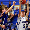 """Longmont's Brett Sterkel (5) grabs a rebound during the game at Longmont High School on Tuesday, Dec. 4, 2012. Longmont beat Fort Lupton 47-34. For more photos visit  <a href=""""http://www.BoCoPreps.com"""">http://www.BoCoPreps.com</a>.<br /> (Greg Lindstrom/Times-Call)"""