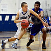 """Longmont RJ Donaldson, left, tries to drive past Fort Lupton's Diondre Morales during the game at Longmont High School on Tuesday, Dec. 4, 2012. Longmont beat Fort Lupton 47-34. For more photos visit  <a href=""""http://www.BoCoPreps.com"""">http://www.BoCoPreps.com</a>.<br /> (Greg Lindstrom/Times-Call)"""