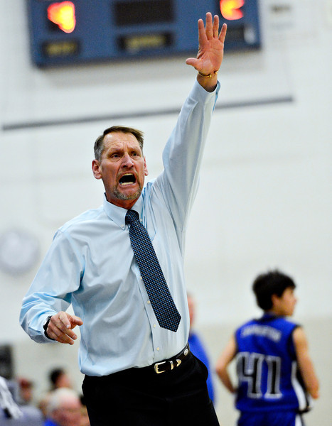 """Longmont head coach Jeff Kloster tries to signal for a substitution during the game at Longmont High School on Tuesday, Dec. 4, 2012. Longmont beat Fort Lupton 47-34. For more photos visit  <a href=""""http://www.BoCoPreps.com"""">http://www.BoCoPreps.com</a>.<br /> (Greg Lindstrom/Times-Call)"""