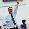 "Longmont head coach Jeff Kloster tries to signal for a substitution during the game at Longmont High School on Tuesday, Dec. 4, 2012. Longmont beat Fort Lupton 47-34. For more photos visit  <a href=""http://www.BoCoPreps.com"">http://www.BoCoPreps.com</a>.<br /> (Greg Lindstrom/Times-Call)"