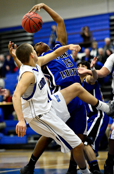 """Longmont's RJ Donaldson, left, and Fort Lupton's Diondre Morales battle for a rebound during the game at Longmont High School on Tuesday, Dec. 4, 2012. Longmont beat Fort Lupton 47-34. For more photos visit  <a href=""""http://www.BoCoPreps.com"""">http://www.BoCoPreps.com</a>.<br /> (Greg Lindstrom/Times-Call)"""