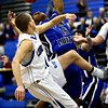 "Longmont's RJ Donaldson, left, and Fort Lupton's Diondre Morales battle for a rebound during the game at Longmont High School on Tuesday, Dec. 4, 2012. Longmont beat Fort Lupton 47-34. For more photos visit  <a href=""http://www.BoCoPreps.com"">http://www.BoCoPreps.com</a>.<br /> (Greg Lindstrom/Times-Call)"