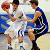 "Longmont's Brett Sterkel, left, is defended by Fort Lupton's Jeff Merritt during the game at Longmont High School on Tuesday, Dec. 4, 2012. Longmont beat Fort Lupton 47-34. For more photos visit  <a href=""http://www.BoCoPreps.com"">http://www.BoCoPreps.com</a>.<br /> (Greg Lindstrom/Times-Call)"