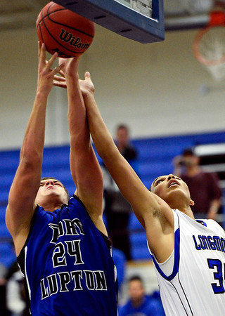 "Longmont's Kevin Mitchell, right, and Fort Lupton's Brodie Nelson compete for a rebound during the game at Longmont High School on Tuesday, Dec. 4, 2012. Longmont beat Fort Lupton 47-34. For more photos visit  <a href=""http://www.BoCoPreps.com"">http://www.BoCoPreps.com</a>.<br /> (Greg Lindstrom/Times-Call)"