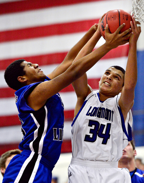 """Longmont's Kevin Mitchell (34) battles for a rebound against Fort Lupton's Diondre Morales during the game at Longmont High School on Tuesday, Dec. 4, 2012. Longmont beat Fort Lupton 47-34. For more photos visit  <a href=""""http://www.BoCoPreps.com"""">http://www.BoCoPreps.com</a>.<br /> (Greg Lindstrom/Times-Call)"""