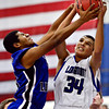 "Longmont's Kevin Mitchell (34) battles for a rebound against Fort Lupton's Diondre Morales during the game at Longmont High School on Tuesday, Dec. 4, 2012. Longmont beat Fort Lupton 47-34. For more photos visit  <a href=""http://www.BoCoPreps.com"">http://www.BoCoPreps.com</a>.<br /> (Greg Lindstrom/Times-Call)"