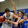 """Longmont's Austin Kemp (21) and Fort Lupton's Jeff Merritt collide on a play during the game at Longmont High School on Tuesday, Dec. 4, 2012. Longmont beat Fort Lupton 47-34. For more photos visit  <a href=""""http://www.BoCoPreps.com"""">http://www.BoCoPreps.com</a>.<br /> (Greg Lindstrom/Times-Call)"""