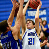 """Longmont's Austin Kemp (21) goes up for a shot over Fort Lupton's Brodie Nelson (24) during the game at Longmont High School on Tuesday, Dec. 4, 2012. Longmont beat Fort Lupton 47-34. For more photos visit  <a href=""""http://www.BoCoPreps.com"""">http://www.BoCoPreps.com</a>.<br /> (Greg Lindstrom/Times-Call)"""