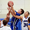 "Fort Lupton's Colton McCutchan grabs a rebound over Longmont's Kevin Mitchell (34) during the game at Longmont High School on Tuesday, Dec. 4, 2012. Longmont beat Fort Lupton 47-34. For more photos visit  <a href=""http://www.BoCoPreps.com"">http://www.BoCoPreps.com</a>.<br /> (Greg Lindstrom/Times-Call)"