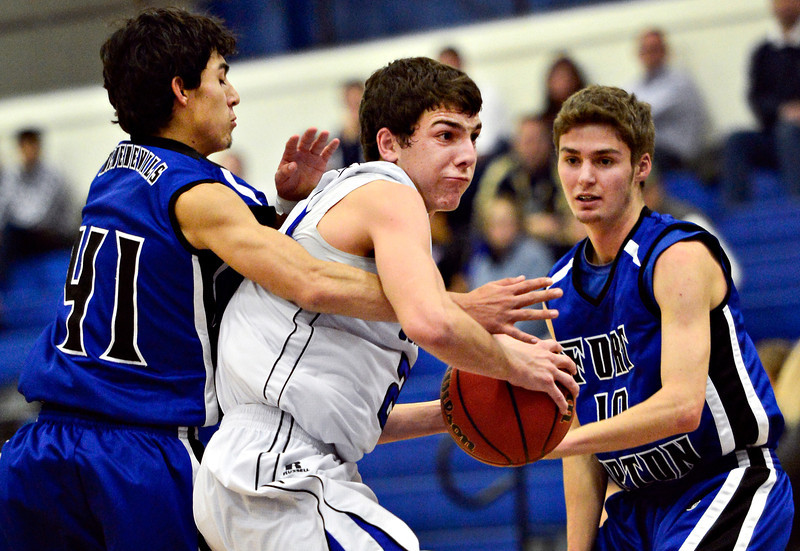 """Longmont's Austin Kemp tries to get past Fort Lupton's Cruz Tijerina (41) and Jeff Merritt during the game at Longmont High School on Tuesday, Dec. 4, 2012. Longmont beat Fort Lupton 47-34. For more photos visit  <a href=""""http://www.BoCoPreps.com"""">http://www.BoCoPreps.com</a>.<br /> (Greg Lindstrom/Times-Call)"""