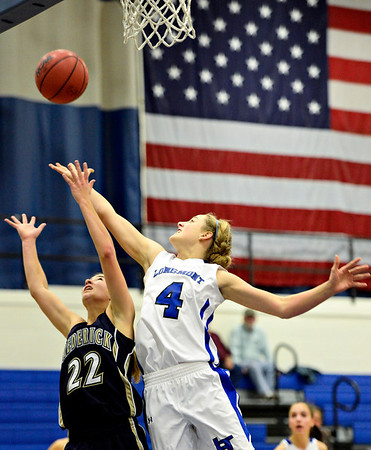 "Longmont's Sydney Wetterstrom (4) and Frederick's Makenzie Urban (22) compete for a rebound during the game at Longmont High School on Monday, Dec. 10, 2012. Longmont beat Frederick 65-43. For more photos visit  <a href=""http://www.BoCoPreps.com"">http://www.BoCoPreps.com</a>.<br /> (Greg Lindstrom/Times-Call)"