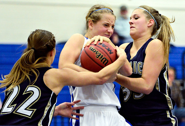 "Frederick's Makenzie Urban (22) and Shyanna Neu (33) try to take a ball from Longmont's Sydney Wetterstrom during the game at Longmont High School on Monday, Dec. 10, 2012. Longmont beat Frederick 65-43. For more photos visit  <a href=""http://www.BoCoPreps.com"">http://www.BoCoPreps.com</a>.<br /> (Greg Lindstrom/Times-Call)"