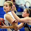 """Longmont's Sydney Wetterstrom drives past Frederick's Sammie Haas during the game at Longmont High School on Monday, Dec. 10, 2012. Longmont beat Frederick 65-43. For more photos visit  <a href=""""http://www.BoCoPreps.com"""">http://www.BoCoPreps.com</a>.<br /> (Greg Lindstrom/Times-Call)"""