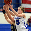 """Longmont's Lyndie Haddock (5) grabs a rebound over Frederick's Shyanna Neu during the game at Longmont High School on Monday, Dec. 10, 2012. Longmont beat Frederick 65-43. For more photos visit  <a href=""""http://www.BoCoPreps.com"""">http://www.BoCoPreps.com</a>.<br /> (Greg Lindstrom/Times-Call)"""