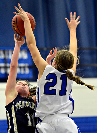 "Longmont's Madi Gaibler (21) blocks a shot by Frederick's Alex Dufour during the game at Longmont High School on Monday, Dec. 10, 2012. Longmont beat Frederick 65-43. For more photos visit  <a href=""http://www.BoCoPreps.com"">http://www.BoCoPreps.com</a>.<br /> (Greg Lindstrom/Times-Call)"