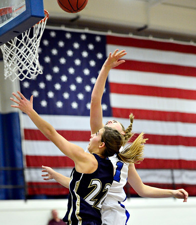 "Frederick's Makenzie Urban (22) puts up a shot over Longmont's Madi Gaibler during the game at Longmont High School on Monday, Dec. 10, 2012. Longmont beat Frederick 65-43. For more photos visit  <a href=""http://www.BoCoPreps.com"">http://www.BoCoPreps.com</a>.<br /> (Greg Lindstrom/Times-Call)"