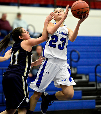 """Longmont's Kathryn Schell (23) tries to shoot over Frederick's Alex Dufour (11) during the game at Longmont High School on Monday, Dec. 10, 2012. Longmont beat Frederick 65-43. For more photos visit  <a href=""""http://www.BoCoPreps.com"""">http://www.BoCoPreps.com</a>.<br /> (Greg Lindstrom/Times-Call)"""