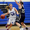 "Longmont's Megan Tulenko (32) drives around Frederick's Sammie Haas (25) during the game at Longmont High School on Monday, Dec. 10, 2012. Longmont beat Frederick 65-43. For more photos visit  <a href=""http://www.BoCoPreps.com"">http://www.BoCoPreps.com</a>.<br /> (Greg Lindstrom/Times-Call)"