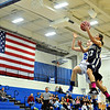 """Frederick's Makenzie Urban (22) goes up for a shot against Longmont's Madi Gaibler during the game at Longmont High School on Monday, Dec. 10, 2012. Longmont beat Frederick 65-43. For more photos visit  <a href=""""http://www.BoCoPreps.com"""">http://www.BoCoPreps.com</a>.<br /> (Greg Lindstrom/Times-Call)"""