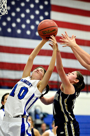 "Longmont's Lydia Pane (10) competes for a rebound against Frederick's Alex Dufour during the game at Longmont High School on Monday, Dec. 10, 2012. Longmont beat Frederick 65-43. For more photos visit  <a href=""http://www.BoCoPreps.com"">http://www.BoCoPreps.com</a>.<br /> (Greg Lindstrom/Times-Call)"