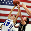 """Longmont's Lydia Pane (10) competes for a rebound against Frederick's Alex Dufour during the game at Longmont High School on Monday, Dec. 10, 2012. Longmont beat Frederick 65-43. For more photos visit  <a href=""""http://www.BoCoPreps.com"""">http://www.BoCoPreps.com</a>.<br /> (Greg Lindstrom/Times-Call)"""