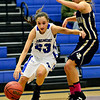 """Longmont's Kathryn Schell (23) tries to drive past Frederick's Makenzie Urban during the game at Longmont High School on Monday, Dec. 10, 2012. Longmont beat Frederick 65-43. For more photos visit  <a href=""""http://www.BoCoPreps.com"""">http://www.BoCoPreps.com</a>.<br /> (Greg Lindstrom/Times-Call)"""