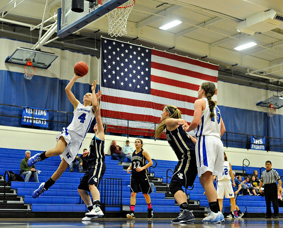 "Longmont's Sydney Wetterstrom (4) goes up for a shot during the game at Longmont High School on Monday, Dec. 10, 2012. Longmont beat Frederick 65-43. For more photos visit  <a href=""http://www.BoCoPreps.com"">http://www.BoCoPreps.com</a>.<br /> (Greg Lindstrom/Times-Call)"