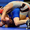 """Longmont's Lane Olsen competes against Greeley Central's Adam Rojas during the wrestling meet at Longmont High School on Thursday, Dec. 6, 2012. For more photos visit  <a href=""""http://www.BoCoPreps.com"""">http://www.BoCoPreps.com</a>.<br /> (Greg Lindstrom/Times-Call)"""