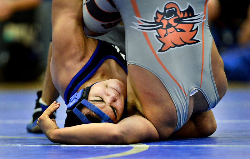 "Longmont's Jaime Ramos Vega competes against Andres Ortega during the wrestling meet at Longmont High School on Thursday, Dec. 6, 2012. For more photos visit  <a href=""http://www.BoCoPreps.com"">http://www.BoCoPreps.com</a>.<br /> (Greg Lindstrom/Times-Call)"