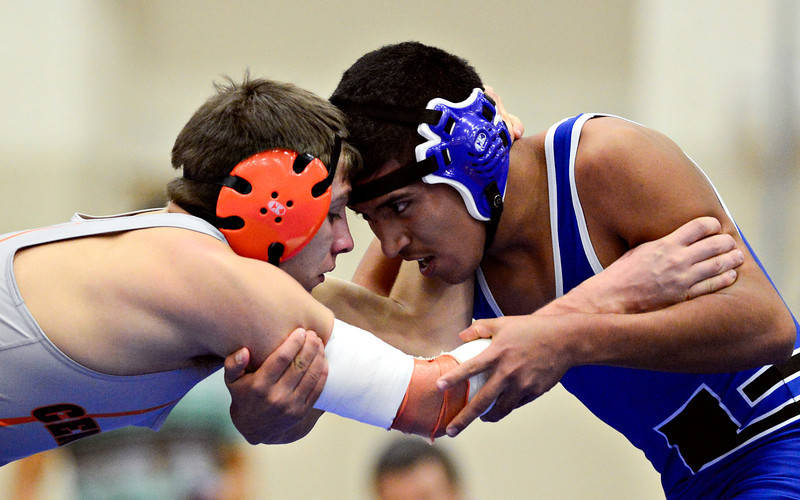 "Longmont's Manuel Sanchez competes against Greeley Central's Donovan Alirez during the wrestling meet at Longmont High School on Thursday, Dec. 6, 2012. For more photos visit  <a href=""http://www.BoCoPreps.com"">http://www.BoCoPreps.com</a>.<br /> (Greg Lindstrom/Times-Call)"