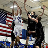 "Longmont's Kevin Mitchell (34) competes for a rebound against Mountain View players during the game at Longmont High School on Tuesday, Jan. 22, 2013. Longmont beat Mountain View 75, Mountain View 38. For more photos visit  <a href=""http://www.BoCopreps.com"">http://www.BoCopreps.com</a><br /> (Greg Lindstrom/Times-Call)"