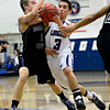 "Longmont's Felipe Alaniz (3) tries to drive past Mountain View's Jonah Kunisch (1) during the game at Longmont High School on Tuesday, Jan. 22, 2013. Longmont beat Mountain View 75, Mountain View 38. For more photos visit  <a href=""http://www.BoCopreps.com"">http://www.BoCopreps.com</a><br /> (Greg Lindstrom/Times-Call)"