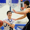 "Longmont's Austin Kemp (21) is pressured by Mountain View's Tyler Kress (2) during the game at Longmont High School on Tuesday, Jan. 22, 2013. Longmont beat Mountain View 75, Mountain View 38. For more photos visit  <a href=""http://www.BoCopreps.com"">http://www.BoCopreps.com</a><br /> (Greg Lindstrom/Times-Call)"