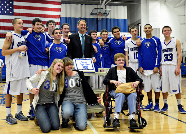 "Longmont head coach Jeff Kloster, center, is pictured with family and his team after the game at Longmont High School on Tuesday, Jan. 22, 2013. Longmont beat Mountain View 75, Mountain View 38. For more photos visit  <a href=""http://www.BoCopreps.com"">http://www.BoCopreps.com</a><br /> (Greg Lindstrom/Times-Call)"