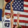 "Longmont's Marcus Johnson (45) shoots over Mountain View's Noah Fisher (11) during the game at Longmont High School on Tuesday, Jan. 22, 2013. Longmont beat Mountain View 75, Mountain View 38. For more photos visit  <a href=""http://www.BoCopreps.com"">http://www.BoCopreps.com</a><br /> (Greg Lindstrom/Times-Call)"
