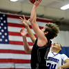 "Mountain View's Hunter Porterfield (10) shoots over Longmont's Kevin Mitchell (34) during the game at Longmont High School on Tuesday, Jan. 22, 2013. Longmont beat Mountain View 75, Mountain View 38. For more photos visit  <a href=""http://www.BoCopreps.com"">http://www.BoCopreps.com</a><br /> (Greg Lindstrom/Times-Call)"